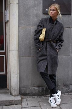 Coat and adidas sneakers