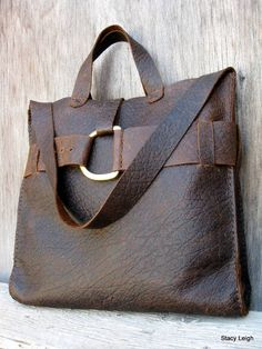 Rugged, distressed, cowhide leather in a chocolate brown color. The leather is not stiff , it has a medium temper. Unlined with one inside drop in