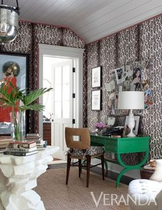 Love everything! The green, the matching wallpaper and fabric, the pink trim detail on the walls, great interior!