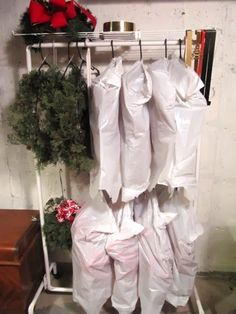 Christmas storage idea: If you go big when it comes to wreaths (we're talking every window, inside and out!) and don't have space in your closet for storage, invest in a clothing rack and keep 'em wrapped in plastic in your basement or garage. See more at Sew Many Ways »   - CountryLiving.com