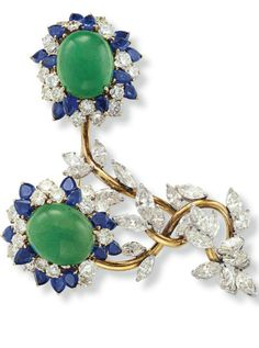 AN EMERALD, DIAMOND AND SAPPHIRE FLOWER BROOCH Designed as two flowers, with cabochon emerald pistils, extending circular-cut diamond and pear-shaped sapphire petals, to the sculpted gold stems and marquise-cut diamond leaves, mounted in white and yellow gold