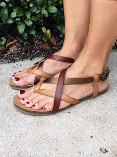 These shoes come in a pretty criss cross strappy style. One strap is metallic, one is leather, and another is a matte tan. These shoes will match whatever you pair them with! Cute Sandals, Brown Sandals, Cute Shoes, Leather Sandals, Me Too Shoes, Shoes Sandals, Women Sandals, Strappy Sandals, Wedge Heels