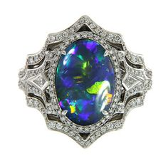 Lightining Ridge Black Opal ring with diamonds by @FlorenceKat