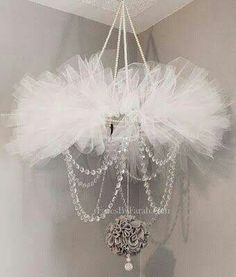Hula hoop decorated with tulle ribbon and jewels! Amazing. Chandler