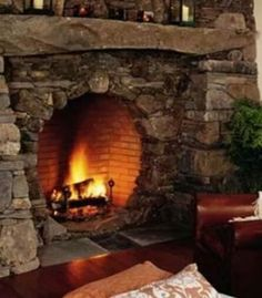I love this hobbit style fireplace for a master bedroom.