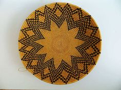 African Basket - 15.5 inches wide $50.00   The baskets sold by Shona Village were made in Zimbabwe by groups of women in a remote rural part of Masvingo Province using plant fibers. They are part of a women's cooperative. It takes a lot of skill and time to weave one basket. The baskets are very sturdy and are both functional and decorative. Each basket is unique. This basket is approximately 15.5 inches in diameter and approximately 3 inches tall. It is a very beautifully made basket.