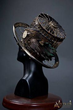 Steampunk Tendencies #millinery #hats #judithm. I like the idea of a metal cage for a hat, maybe even repurposed/upcycled.