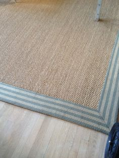 Wide stripe border on a sea grass rug. So great. So Something's Gotta Give!