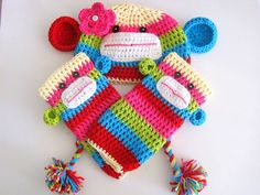 So bright and colorful! Candyland Sock Monkey and Leg Warmers by leiguzman