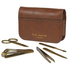 Ted Baker manicure kit, great gift for man or a woman. All items gold coloured and supplied in a vegan faux leather case. Also available from Modcloth in the States