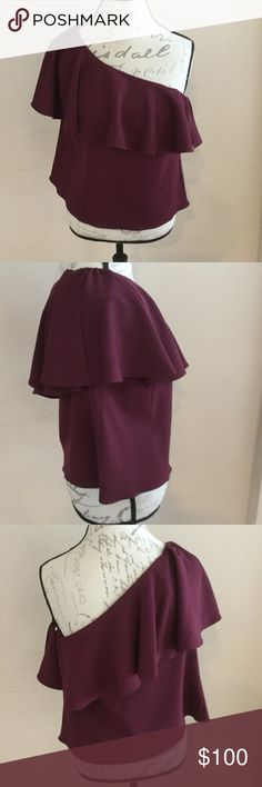 AMANDA UPRICHARD CRANBERRY OFF SHOULDER SHIRT AMANDA UPRICHARD NWT CRANBERRY ONE SHOULDER SHIRT. AMAZING STYLE AND COLOR.  WINE COLOR. RUFFLES IN THE FRONT. NEVER WORN Amanda Uprichard Tops