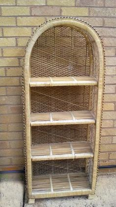 VINTAGE WICKER 4-SHELF CABINET, Good condition.    got this one in my dining room. holds all my yarn and vintage craft books. I've had it since I was 10 yrs old