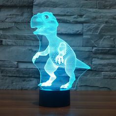 Dinosaur LED illusion Night Light 7 Change Color Touch Switch Table Desk Lamp is solid and can change color, light is getting more and more attention-NewChic. Nocturne, Illusion 3d, Dinosaur Light, Dinosaur Bedroom, 3d Optical Illusions, Touch Table Lamps, 3d Light, Light Touch, Novelty Lighting