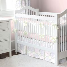 Pink Modern Floral Three-Piece Crib Bedding Set by Carousel Designs.