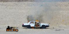 Blow up a car filled with explosives!
