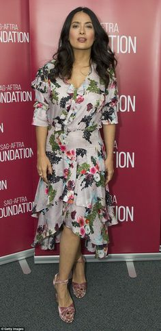 Style queen: Salma Hayek showcased he flawless fashion sense on Wednesday in LA as she wore a floral-themed frock with asymmetrical hem and rose-colored open-toe heels