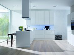 White has never failed to provide a lasting kitchen design. This stylish kitchen, including everything from white kitchen cabinets to sleek white tiles, is sure to be an inspiration for your own ki… Modern Kitchen Flooring, Kitchen Cabinet Design, Kitchen Design Decor, Kitchen Flooring, Contemporary Kitchen, Kitchen Wall Units, Modern White Kitchen Cabinets, Modern Kitchen Design, Minimalist Kitchen