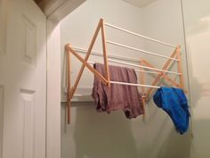 This ingenious trick takes a standing drying rack and hangs it on the wall to free up floor space. When not in use, it quickly collapses out of the way.
