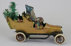 FISCHER tin litho Father Christmas car with feather tree in back seat, circa 1912