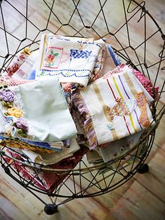 Stack old tea towels in a vintage metal laundry basket, to keep them on display!