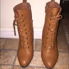 Ankle boots All brown ankle boots . Worn one time . Heel is a platform . Very comfortable . But brown im good with pairing it up with the right outfit . Good condition . Box comes with the shoes Shoes Ankle Boots & Booties