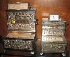 Early cast iron draw poker machine manufactured by Puritan in 1906. Unique feature with the hold and draw levers above the reels. The Pilgrim is much bigger than the Caille Puritan.