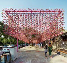 A New Pavilion In Beijing Features 15000 Brightly Colored Shuttlecocks As part of Beijing Design Week Sebastian Loaiza of SPARK has designed the Janzi Box a pavilion in Sanqingguan nbsp hellip Temporary Architecture, Landscape Architecture, Architecture Design, Bamboo Structure, Shade Structure, Urban Landscape, Landscape Design, Street Installation, Urban Intervention