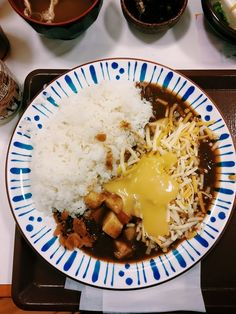 Sukiya (すき屋) chain restaurant at Kawaramachi Sanjo. That's my Japanese curry rice with cheese
