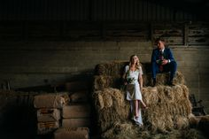 Image by  Babb Photo - A rustic wedding with a tipi reception venue with the bride in an embellished dress and groom in a blue suit. Handmade wedding favours and tassel garlands. Photography by Laura Babb.