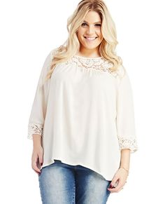 "<p>We are head over heels for this beautiful blouse featuring a floral crochet inset along the the front and 3/4 sleeve trim, squared illusion neckline, back keyhole with button closure, and a flounce bottom.</p>  <p>Model is 5'9"" and wears a size 1X</p>  <ul> 	<li>100% Polyester</li> 	<li>Hand Wash</li> 	<li>Imported</li> </ul>"