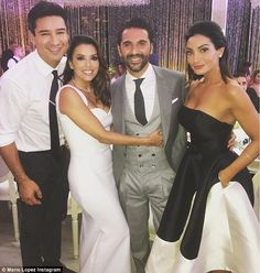 Blushing bride: Eva looked gorgeous in her Victoria Beckham designed dress as she posed with her new husband and Mario Lopez