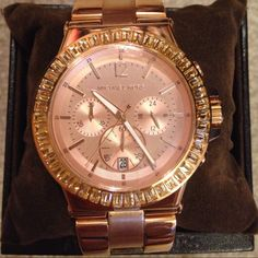 Michael Kors Rose Gold Watch MK5412 Michael Kors Ladies Dylan Glitz Chronograph Rose Gold Watch style MK5412. 46 clear stones surround the dial. Gorgeous!! Chronograph function. Rose gold plated stainless steal case and band. Brand New and never worn! Protective plastic sticker still on face of watch. Comes with box and booklet. Michael Kors Jewelry