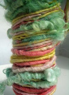 "MyMixMix on Etsy. Poquito skein of ""Surprise"" hand-spun art yarn from Wensleydale locks with corespun BFL/silk."