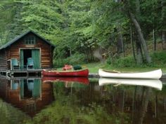 lake side cottage with red canoe
