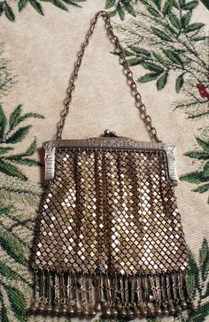 1920s German Silver Mesh Purse-Flapper Era and in very good condition Inside frame Marked G. Silver and M.M.&R. Skirt fringe is all intact-Clasp