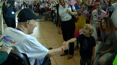 Hundreds of family and friends waited for 76, mostly World War II, veterans on the Honor Flight. The vets returned from Washington, DC after visiting the WWII Memorial, the Vietnam Memorial, Arlington Cemetery...