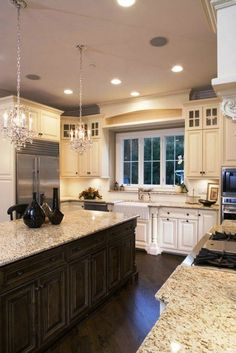 Beautiful cream colored kitchen with Bianco Antico counters. (Top Design Cabinets)
