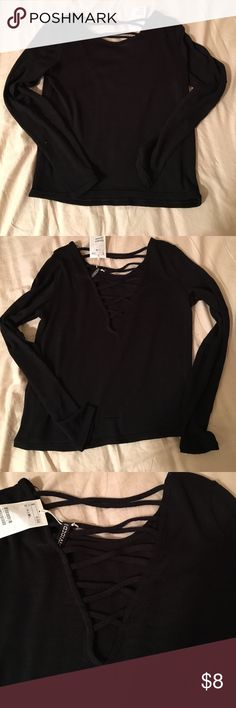 Divided black crop top M Brand new, never worn, with tags black crop top size M.  Sexy crossings in the back. Fits like S H&M Tops Crop Tops