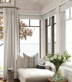 What a lovely, bright, cozy-looking spot to laze away a summer afternoon, maybe read a book and drink some iced tea...