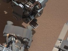 NASA - View of Curiosity's First Scoop Also Shows Bright Object