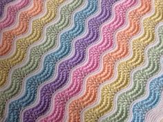 Feather and Fan wavy baby blanket in gorgeous pastel colours.