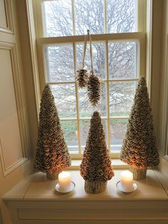 DECEMBER 20, 2012 My Holiday Brunch - Part One | Windowsills were decorated with gilded pine cone trees.