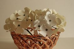 Exquisite paper hydrangeas perfect for a rustic or romantic wedding table centerpiece, baby or bridal shower decoration.  bloom is approximately 6 inches in diameter (petals tip to tip). Each bloom includes approximately 30 -36 individual flowers. Stems are approximately 12 inches in length, but can easily be bent or trimmed . It can be used for wedding decor ... like adding more texture to the paper flower backdrop . I have added a picture so you can have an idea . how it goes well with…