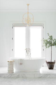 Stand alone tub with open windows in California Traditional Interior Design | Studio McGee Design Blog