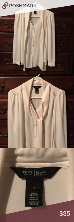White House Black Market Blouse 100% Polyester cream White House Black Market blouse with puffy sleeves, button down & asymmetrical bottom. Also has an attached scarf. In break on condition!! Size 0 White House Black Market Tops Blouses