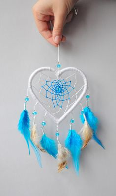 DREAM CATCHER HEART Small dream catcher in white, blue and brown. Can be used a… DREAM CATCHER HEART Small dream catcher in white, blue and brown. Can be used as car rear view mirror hanging. Dream Catcher Patterns, Dream Catcher Decor, Small Dream Catcher, Doily Dream Catchers, Etsy Macrame, Dream Catcher Tutorial, Beautiful Dream Catchers, Crochet Dreamcatcher, Feather Crafts