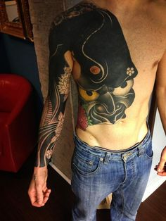 Alessio Manconi - creative heavy black cover-up tattoo work on chest and arms