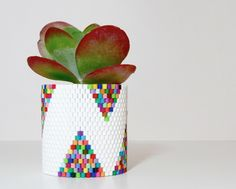 The next time your kids are playing with these iron-happy beads, join 'em and make an planter that'll keep your trendy succulent from taking itself too seriously.