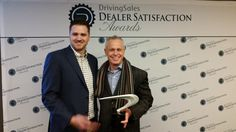 """Thank you to our dealers for awarding us Top Chat Provider from DrivingSales for the fourth year! We're proud to be a #DrivingSales"""" award recipient. CarChat24 Sales VP Jeff Sterns is pictured with Josh Phelon at #NADA2015. We are honored and humbled to serve our dealer partners. #chat #dealerchat #carchat24"""