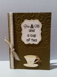 Embossed card with cut-out cup, ribbon and tag.  Custom color to your specifications.
